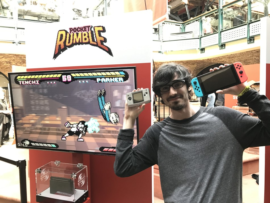 Pocket Rumble developer Christian Stewart, with two of his favourite games consoles